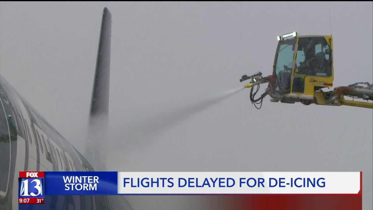 Snow prompts de-icing process at SLC Airport