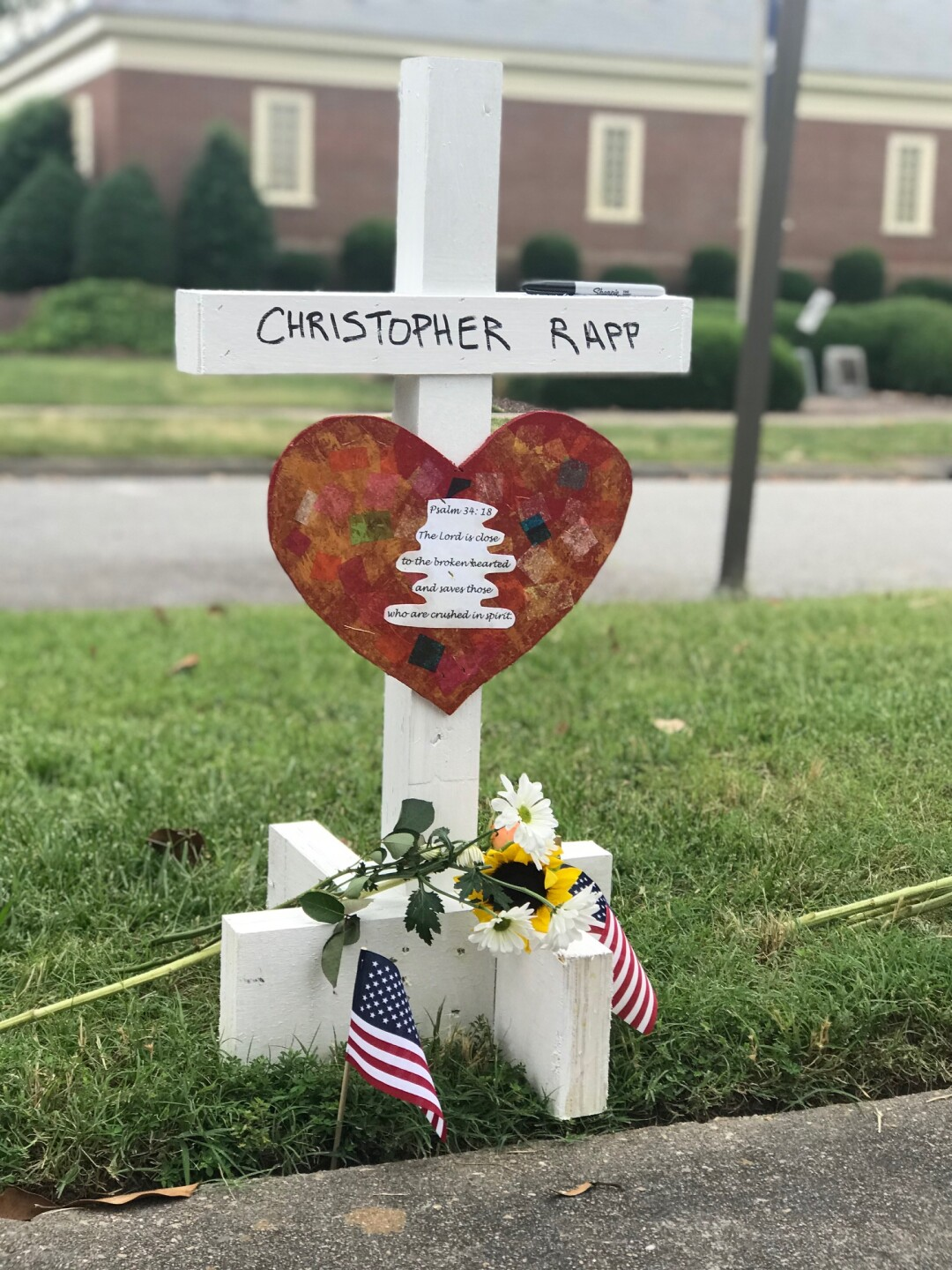 Photos: 'People coming from all over' to Virginia Beach memorial: 'We're suffering, but we arestrong'