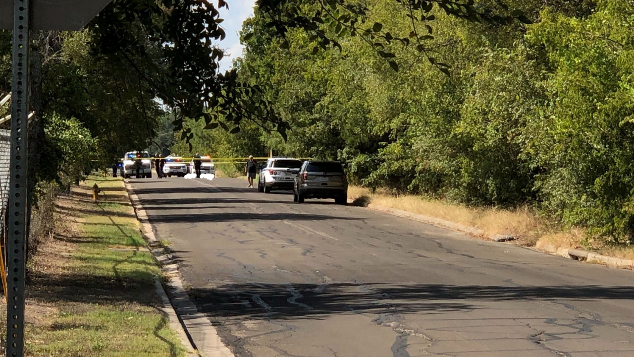 Police: Man with numerous gunshot wounds found dead behind cemetery