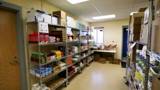 Rice, pasta, canned goods and other shelf-stable food line the shelves of this school-based food pantry in Gallatin County.