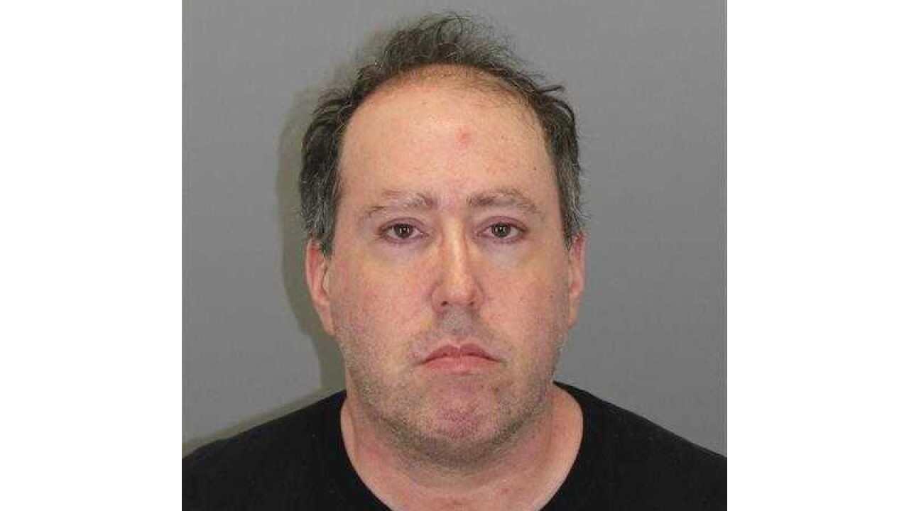 Man arrested at DTW allegedly has history of scamming people for years at other airports
