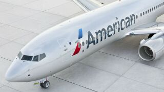 Shirtless man ran off American Airlines plane, threatened airport workers on tarmac, report says