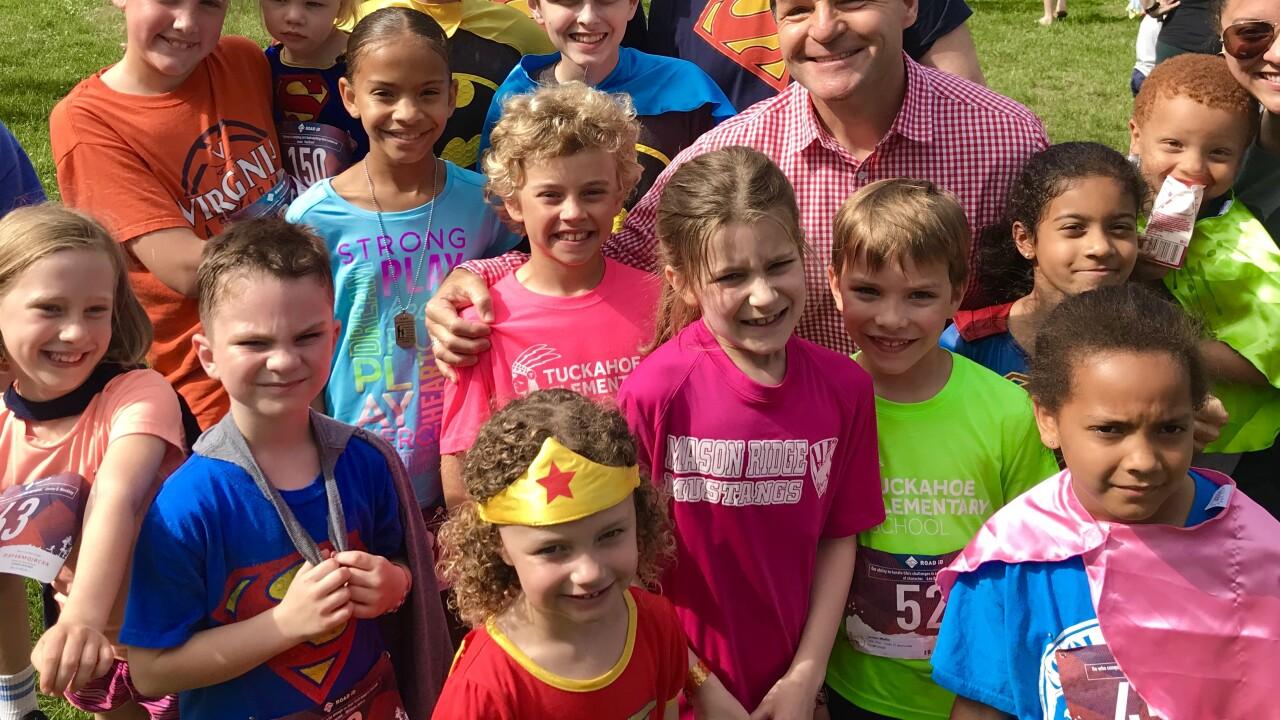 Superhero run raises awareness about childabuse