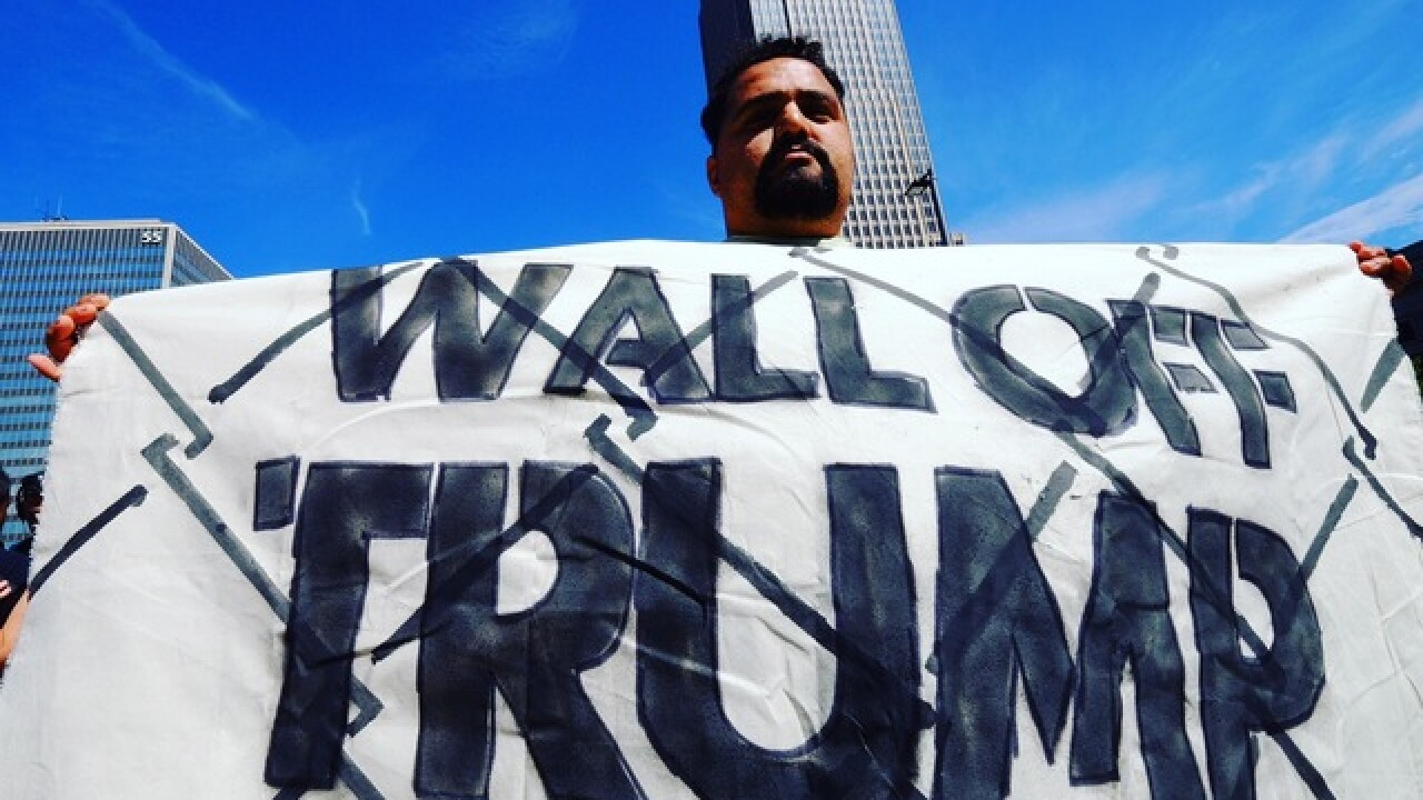 Demonstration tries to 'wall off' Trump