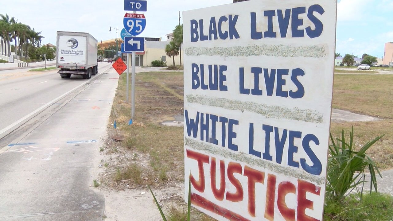 """Sign in Fort Pierce reads """"Black lives, Blue lives, White lives, Justice"""" one year after George Floyd's death"""
