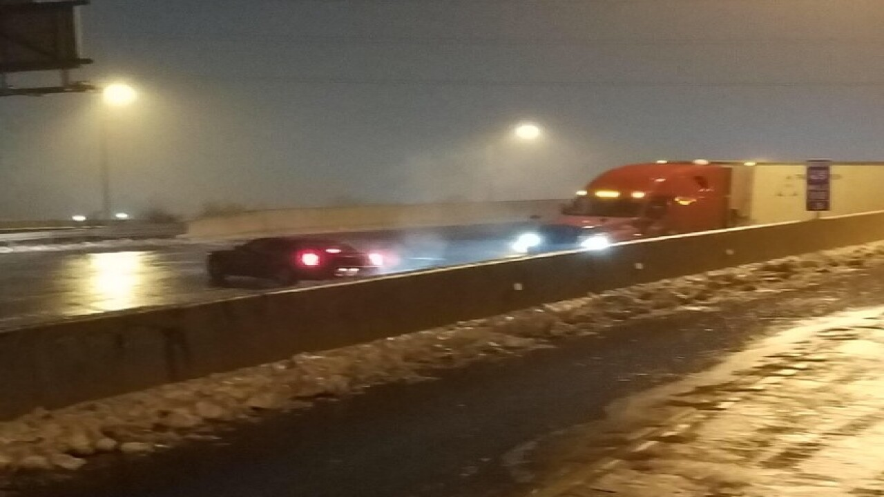 PHOTOS: Freezing rain cause major traffic jams