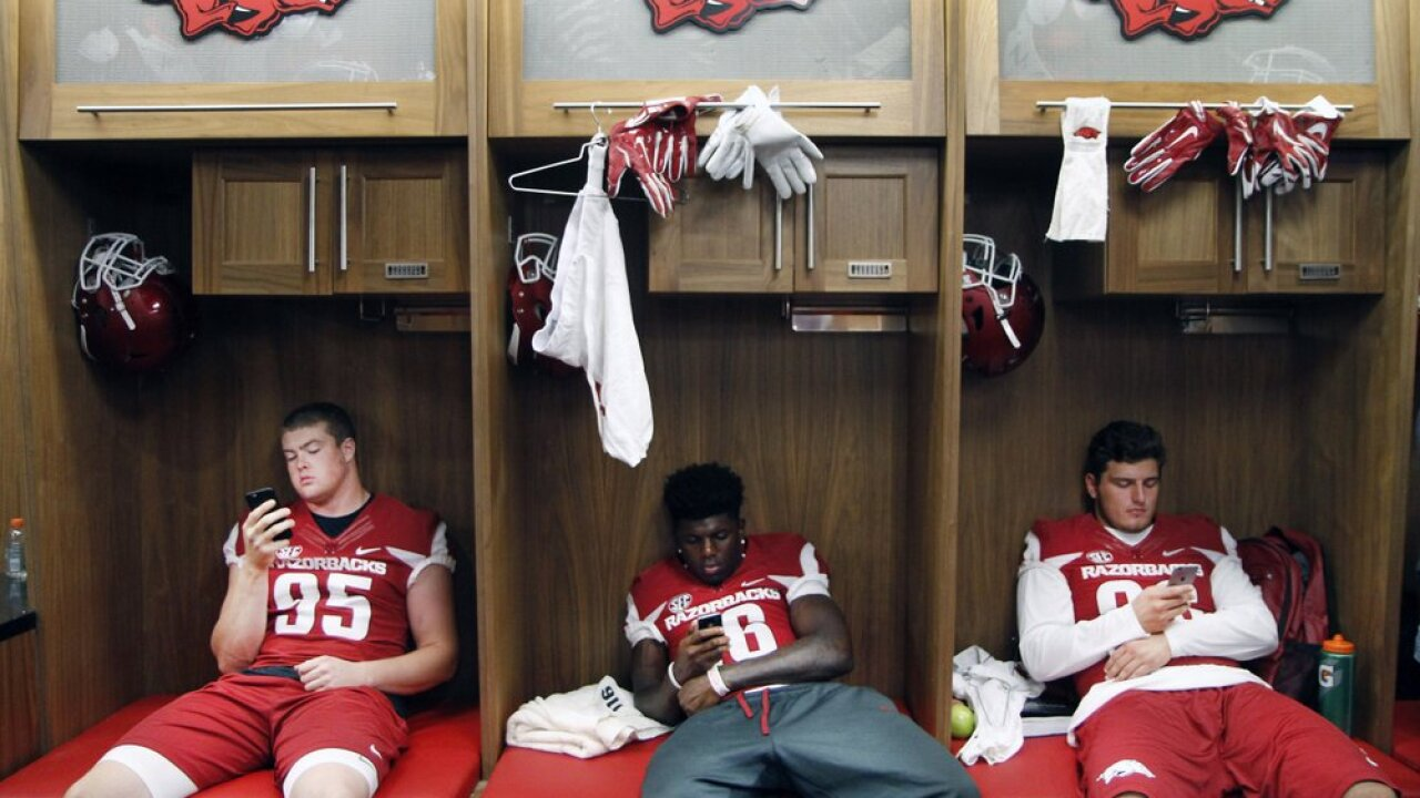 Arkansas' Jake Hall, La'Michael Pettway and Karl Roesler