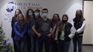 Foothills students present Christmas donation to the Great Falls Rescue Mission