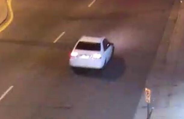 aurora Hit n Run white sedan.jpeg