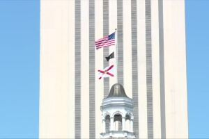 U.S. flag and Florida flag fly outside Capitol building in Tallahassee