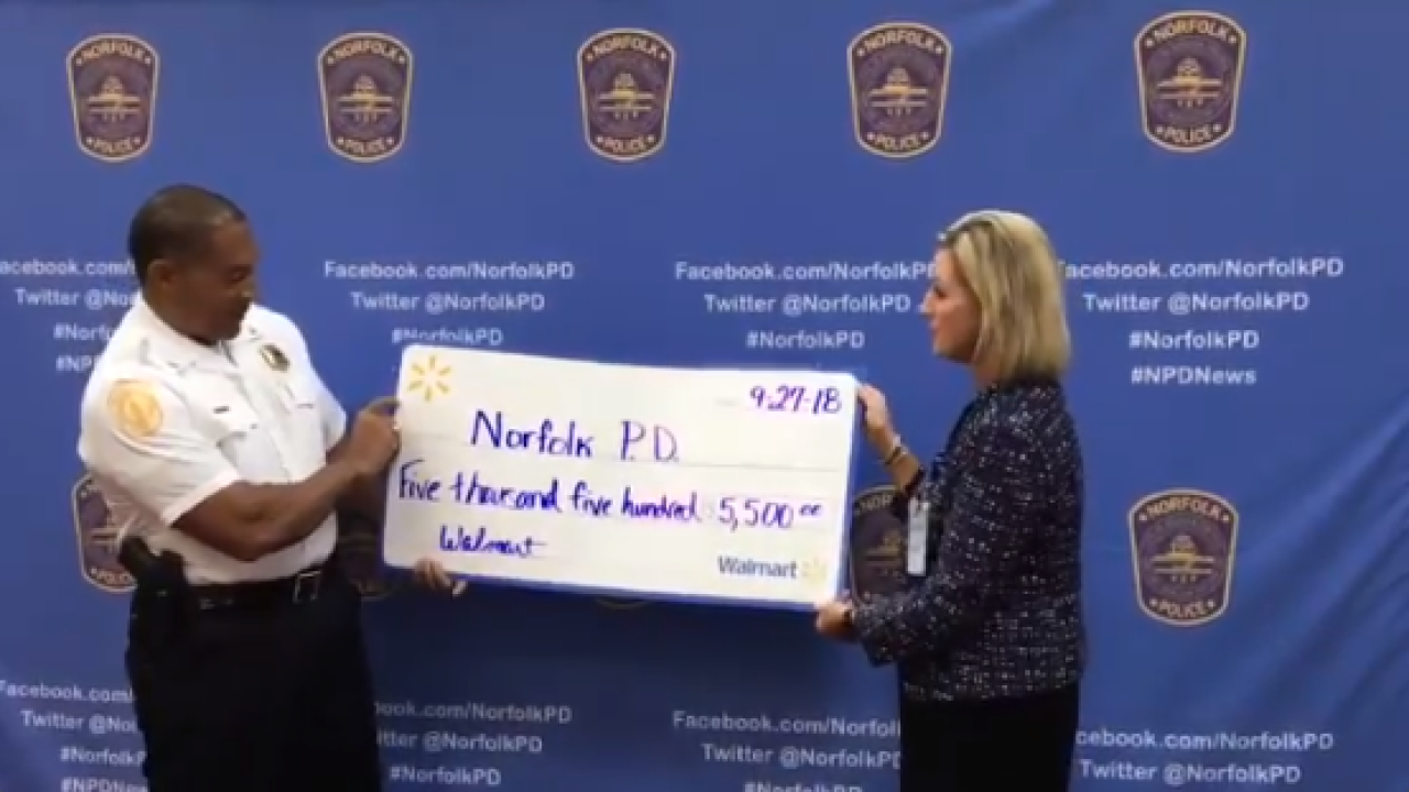 Walmart presents check to NPD for community outreach programs