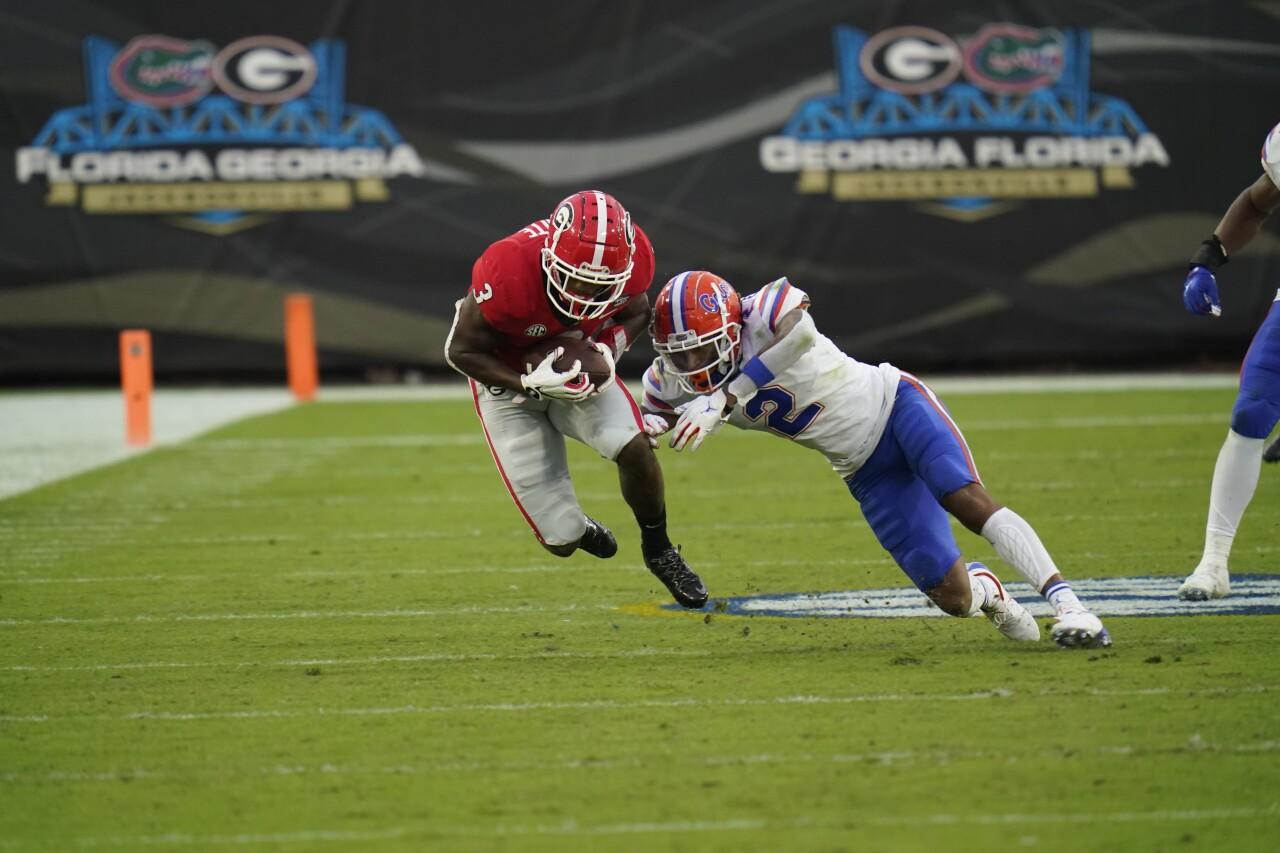 Georgia Bulldogs running back Zamir White stopped by Florida Gators safety Brad Stewart Jr. in 2020