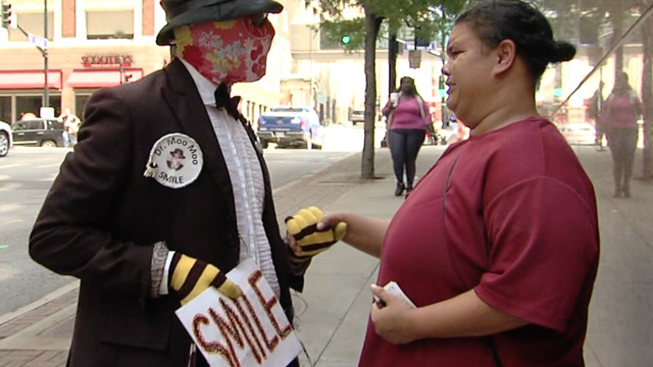 Masked man helps people in need in KC