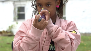 9-year-old Elajah Smithwick-Bey tries the Emocha app