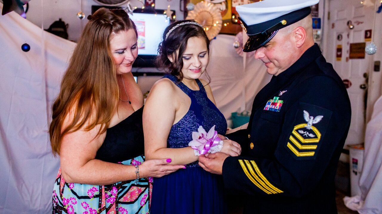 """Virginia Beach neighborhood holds """"garage prom"""" for Navy daughter in cancerremission"""