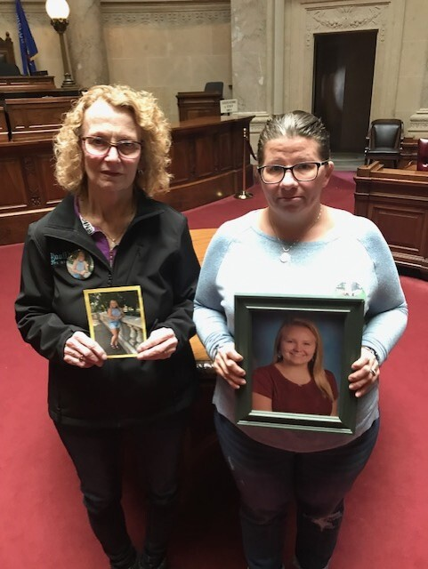 Claudia Church and Dawn Church hold pictures of Hannah Abagail Mae Church.