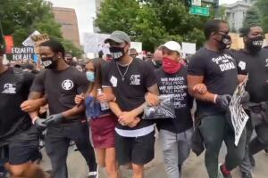 'If you ain't with us, you against us:' Broncos players join protests, lead march through Denver