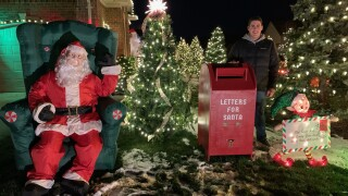 Meet the Michigan teen who decorates his neighbors' homes for Christmas every year