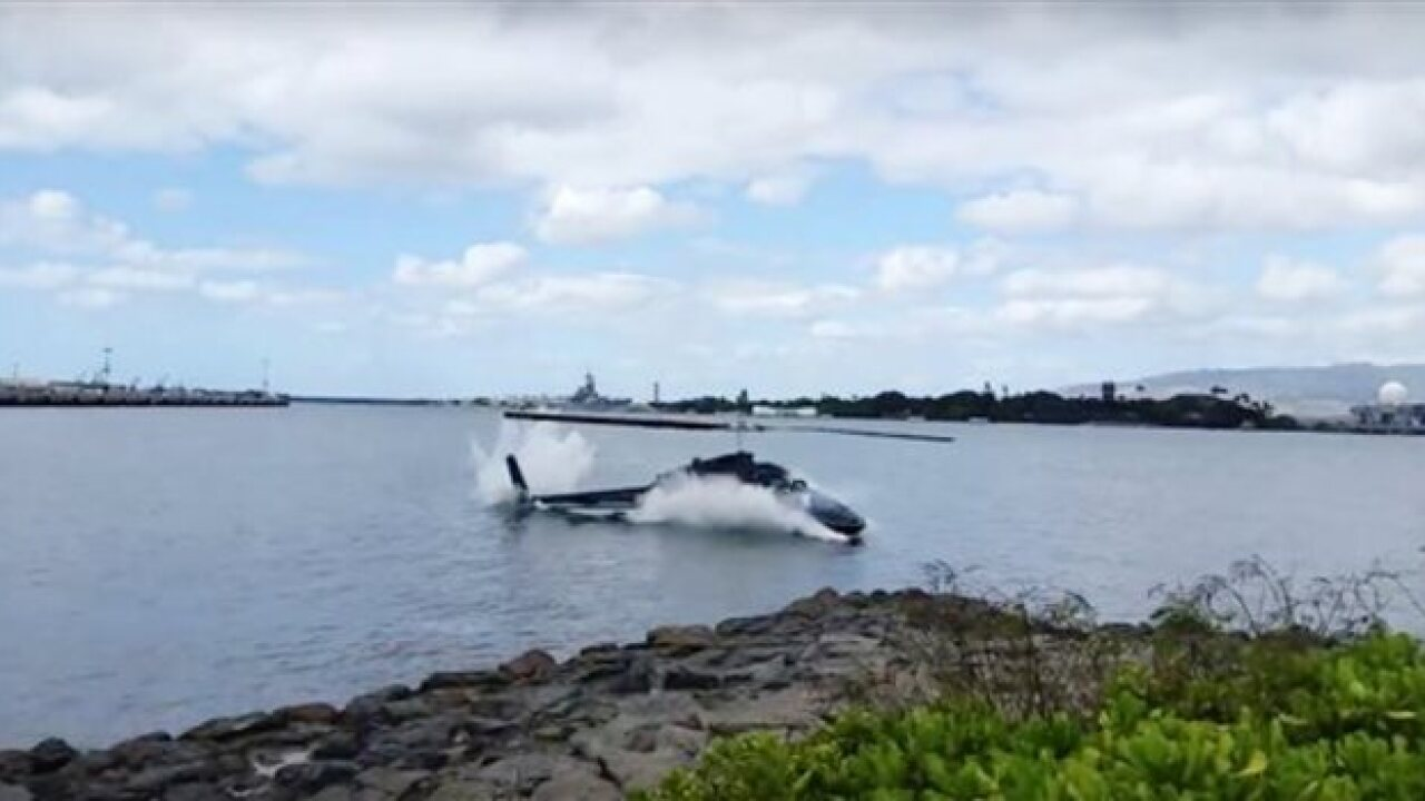 Witness: Helicopter fell from sky into harbor