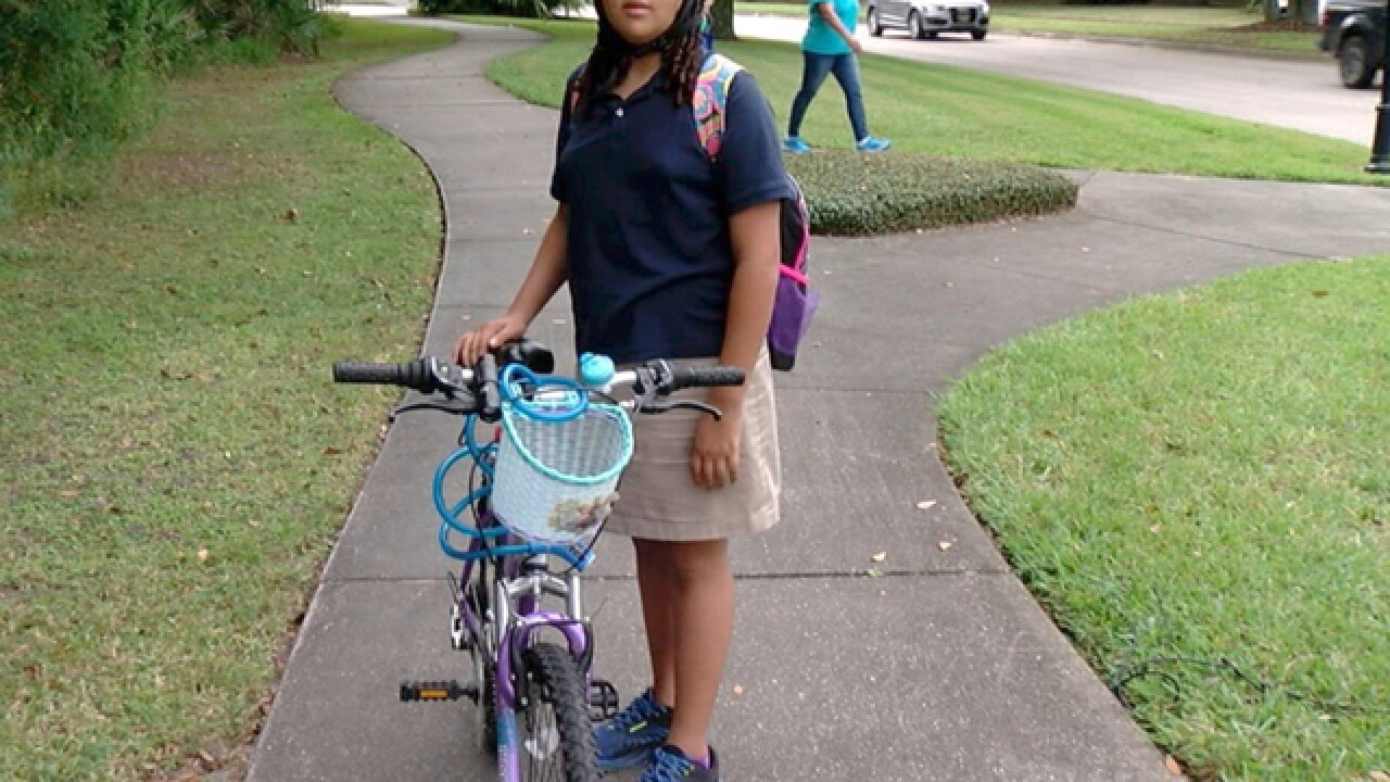 Young girl biking to school almost hit by car