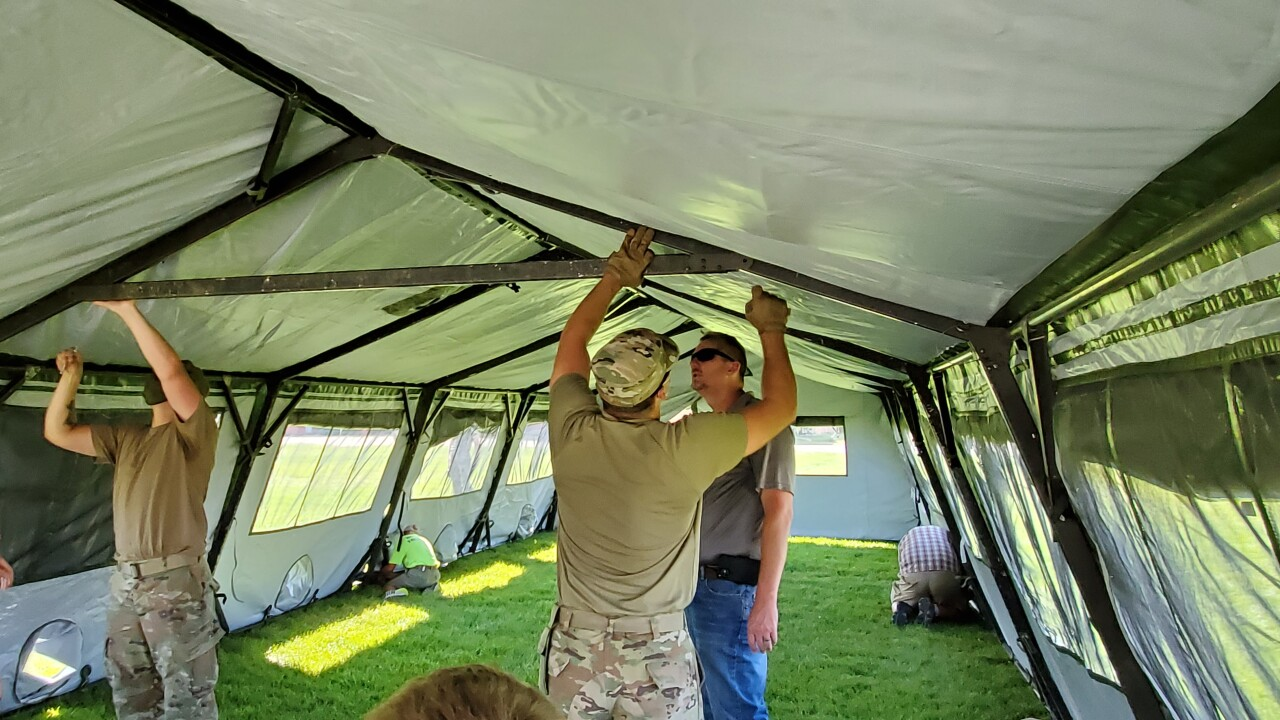 Montana National Guard and boy scouts help set up tents