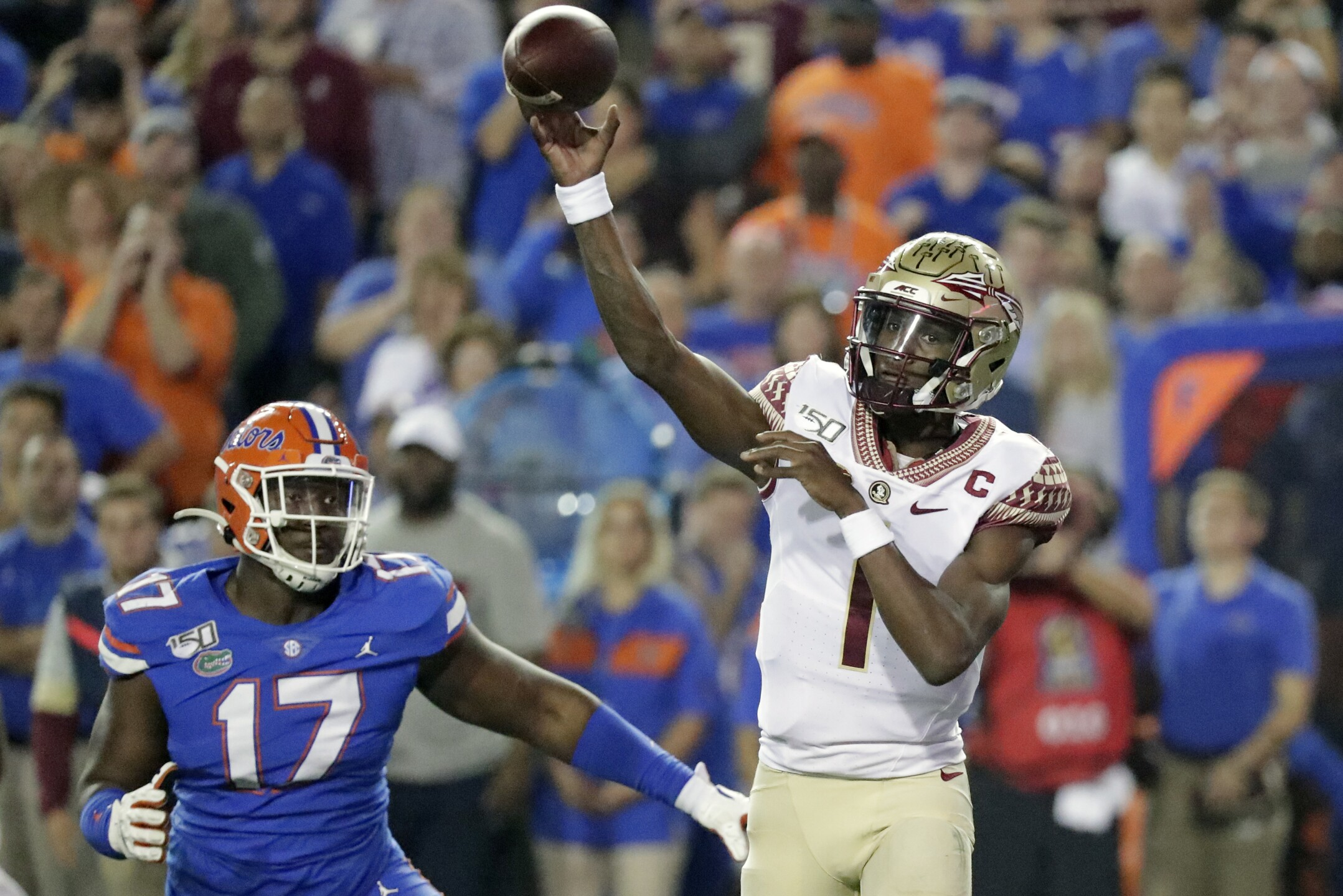 Florida State Seminoles QB James Blackman throws vs Florida Gators in 2019