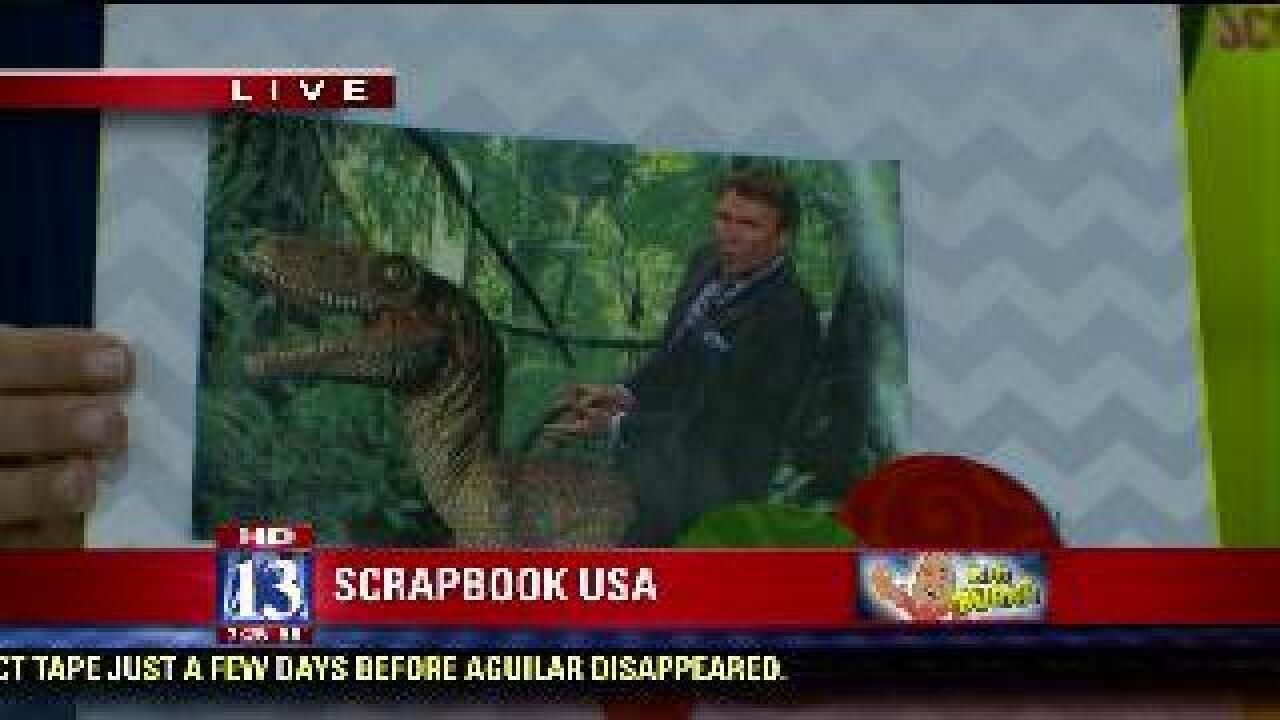 Dan Pope rides dinosaur in scrapbook creation