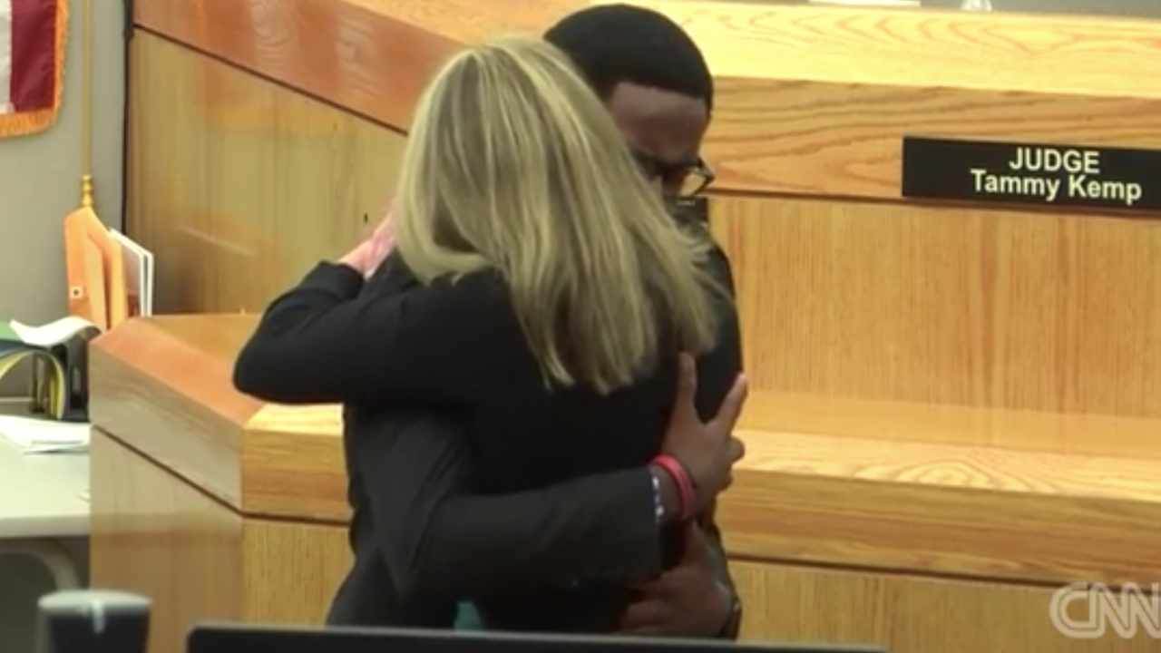 Victim's brother forgives, hugs Amber Guyger before she starts 10-year prison sentence