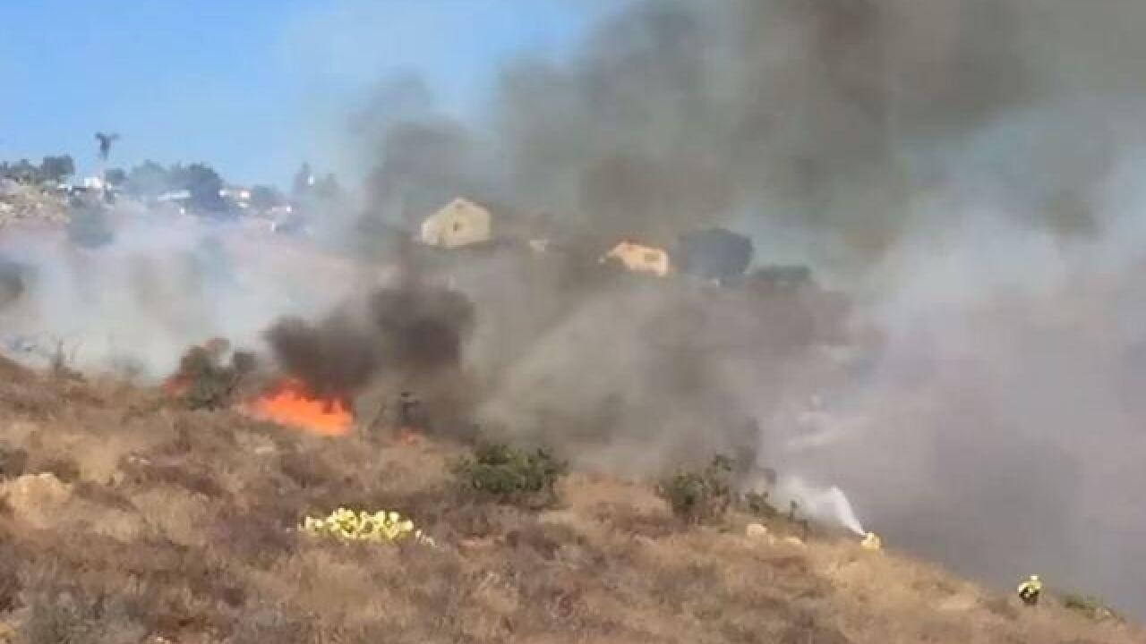 Crews fight brush fire near SR-94 in Lemon Grove