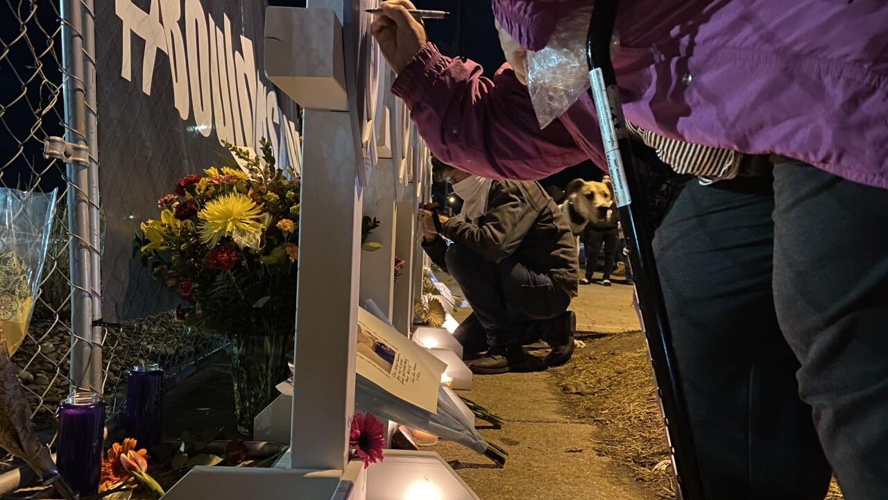 Crosses at vigil in Boulder