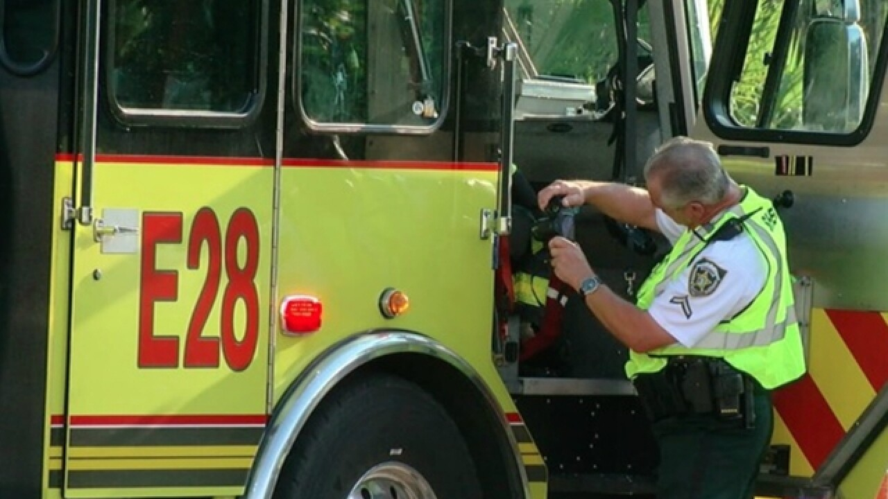 Firefighter hospitalized after falling off truck