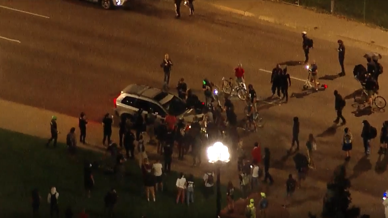 man detained after driving car through crowd of breonna taylor protesters in Denver_sept 23 2020.jpg