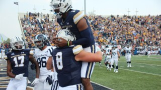 MSU tight end celebrates his touchdown grab with quarterback Matt McKay