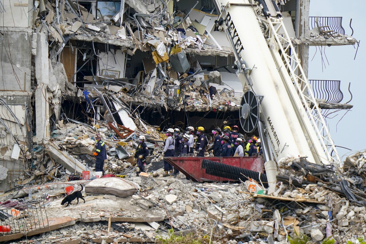 rescuers and dog search rubble of Champlain Towers South condo collapse, June 29, 2021