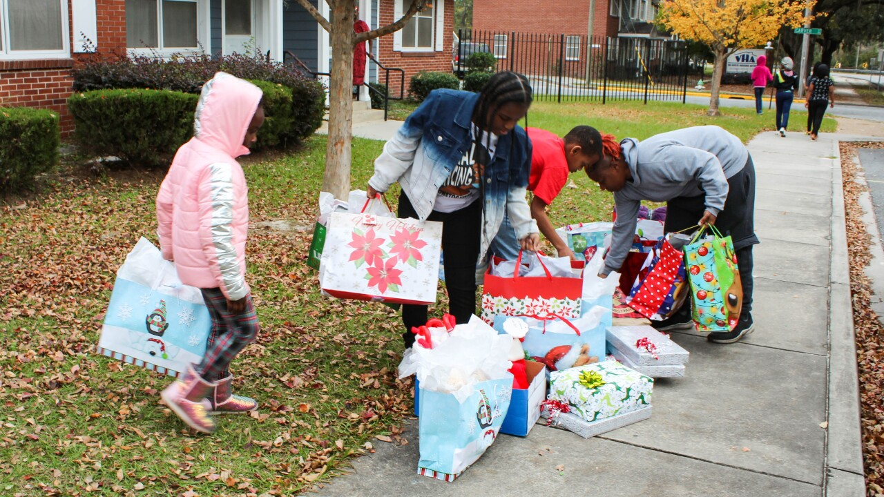 Valdosta Police, community partners surprise family with Christmas donations