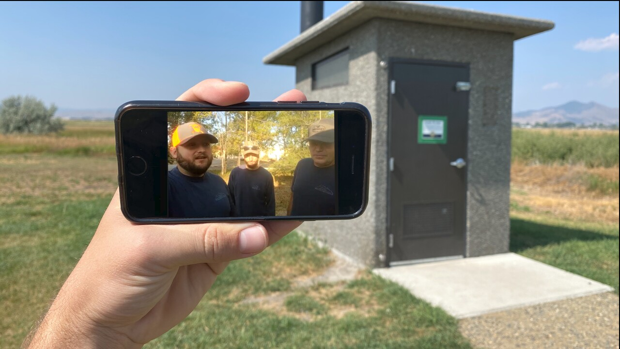 Dropped call: Sanitation crew returns iPhone found in vault toilet