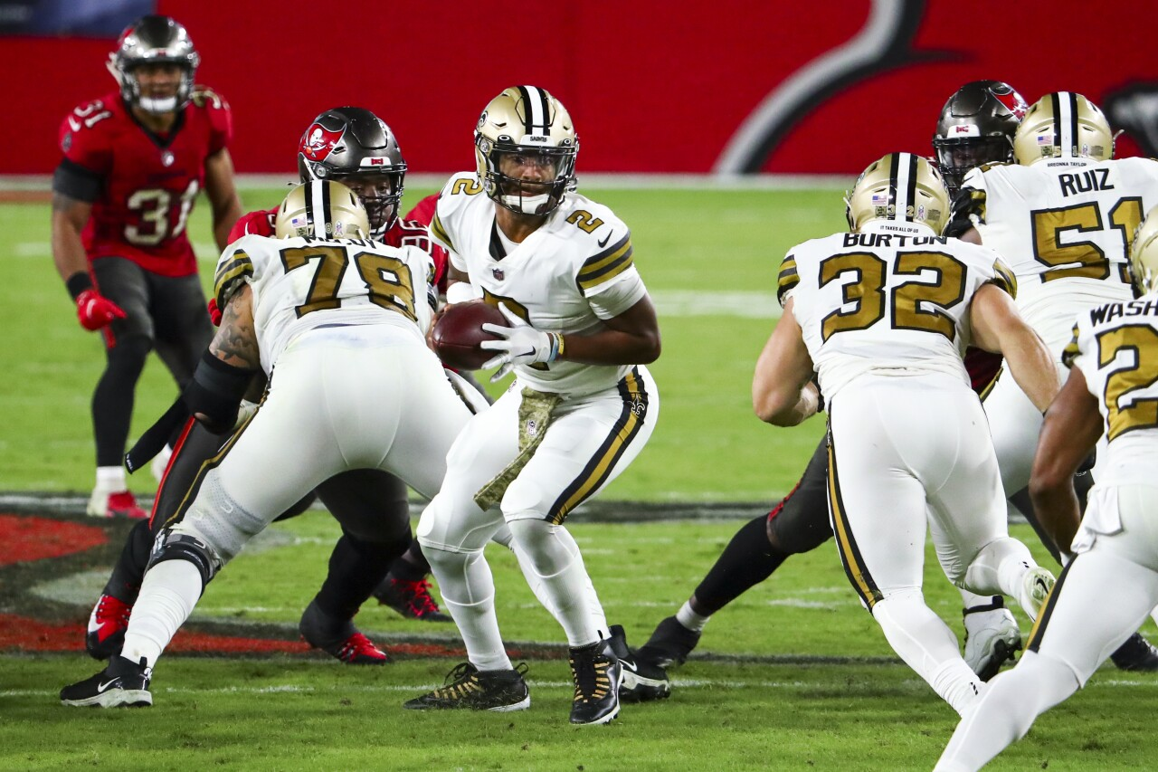 New Orleans Saints QB Jameis Winston hands off football at Tampa Bay Buccaneers in 2020
