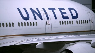 Passenger on United Airlines flight claims he was forced to sit in seat with vomit on it