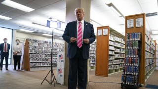 President Donald Trump speaks to reporters after voting at West Palm Beach library, Oct. 24, 2020