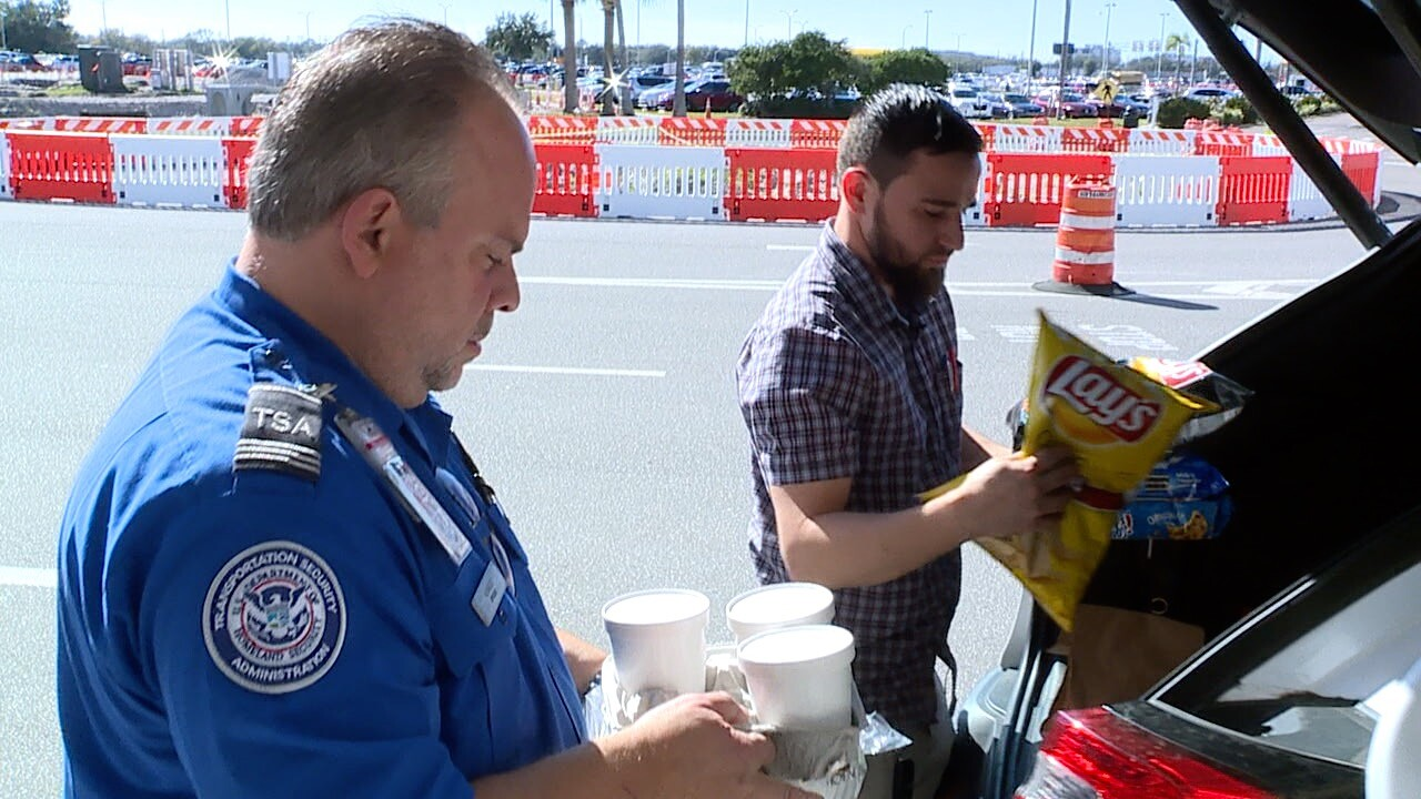 Country Skillet restaurant co-owner Matthew Trizis donating food to TSA agents