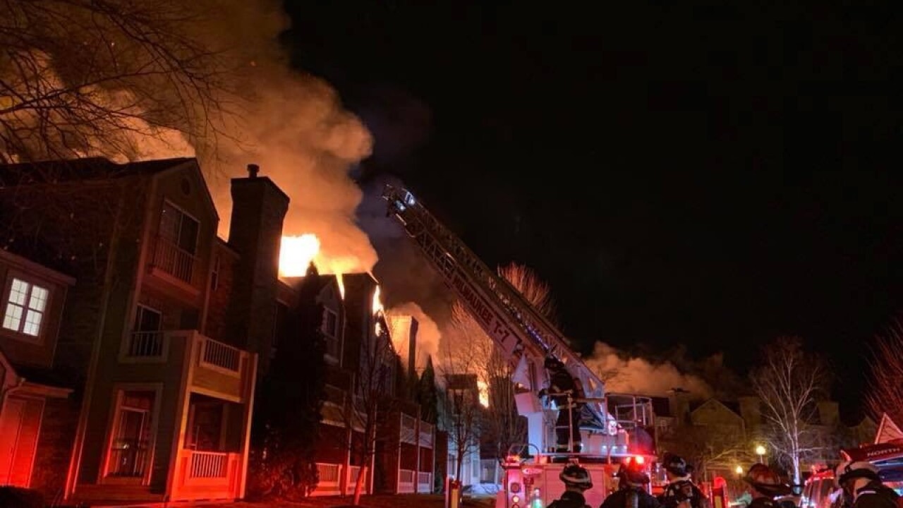 fire departments gather outside huge fire at bayside apartment complex
