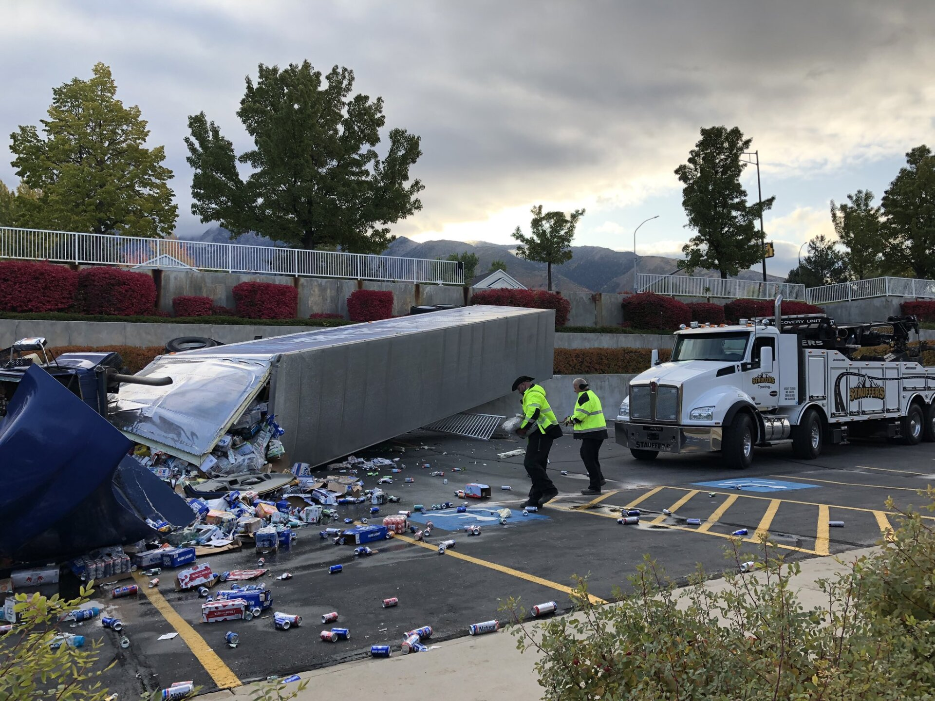Photos: Semi hauling beer spills load across church parking lot in Sandy