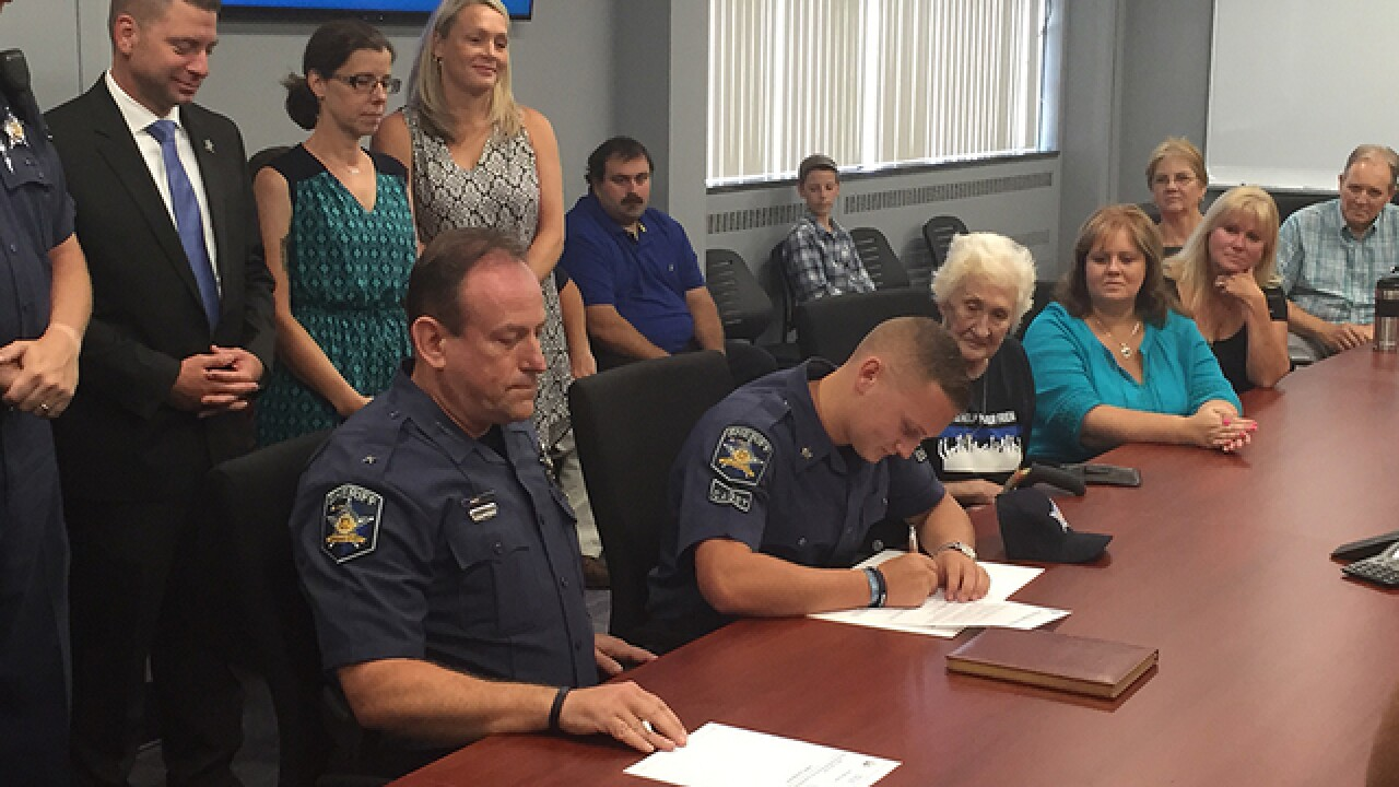 Slain deputy's son joins force in Harford County