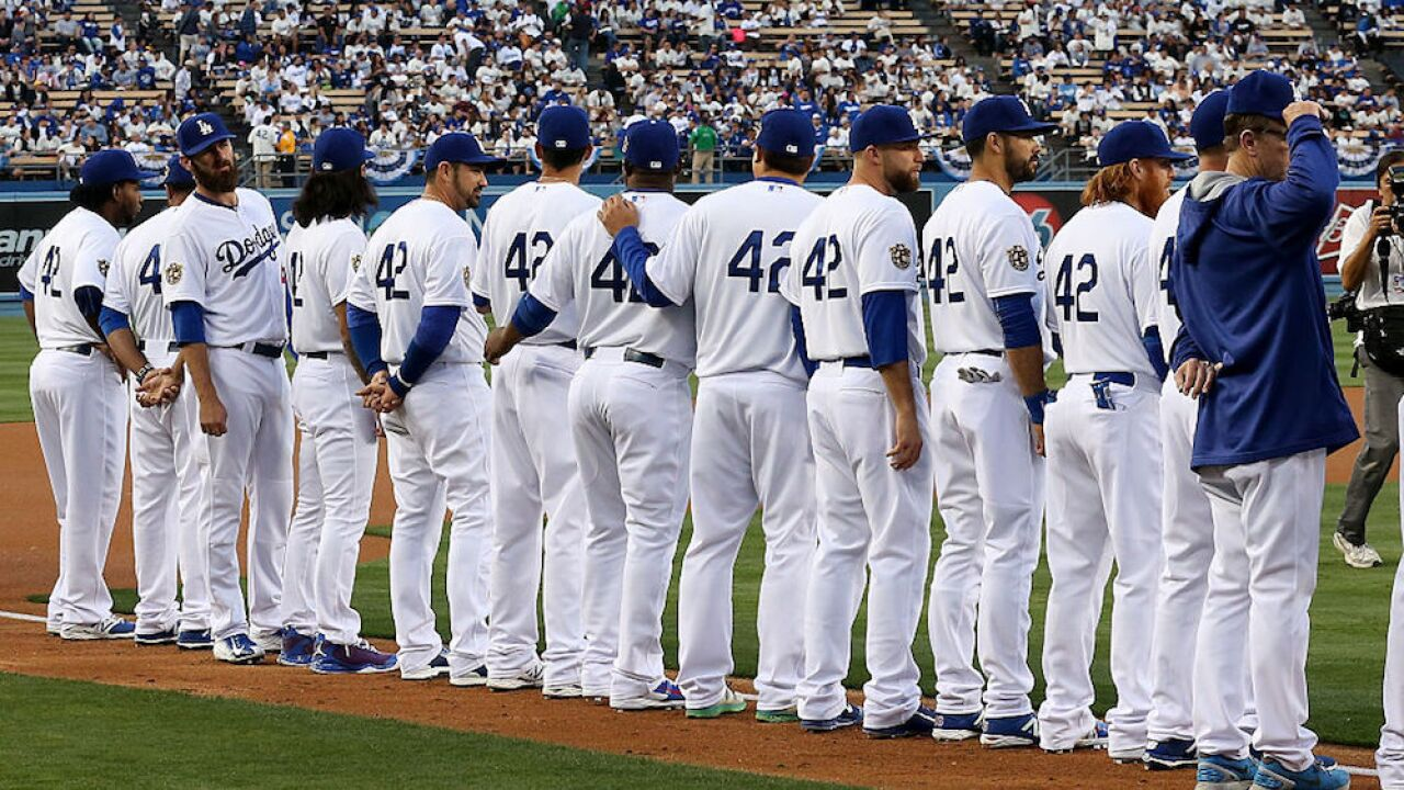 Today, every Major League Baseball player will wear the same number. Here's why