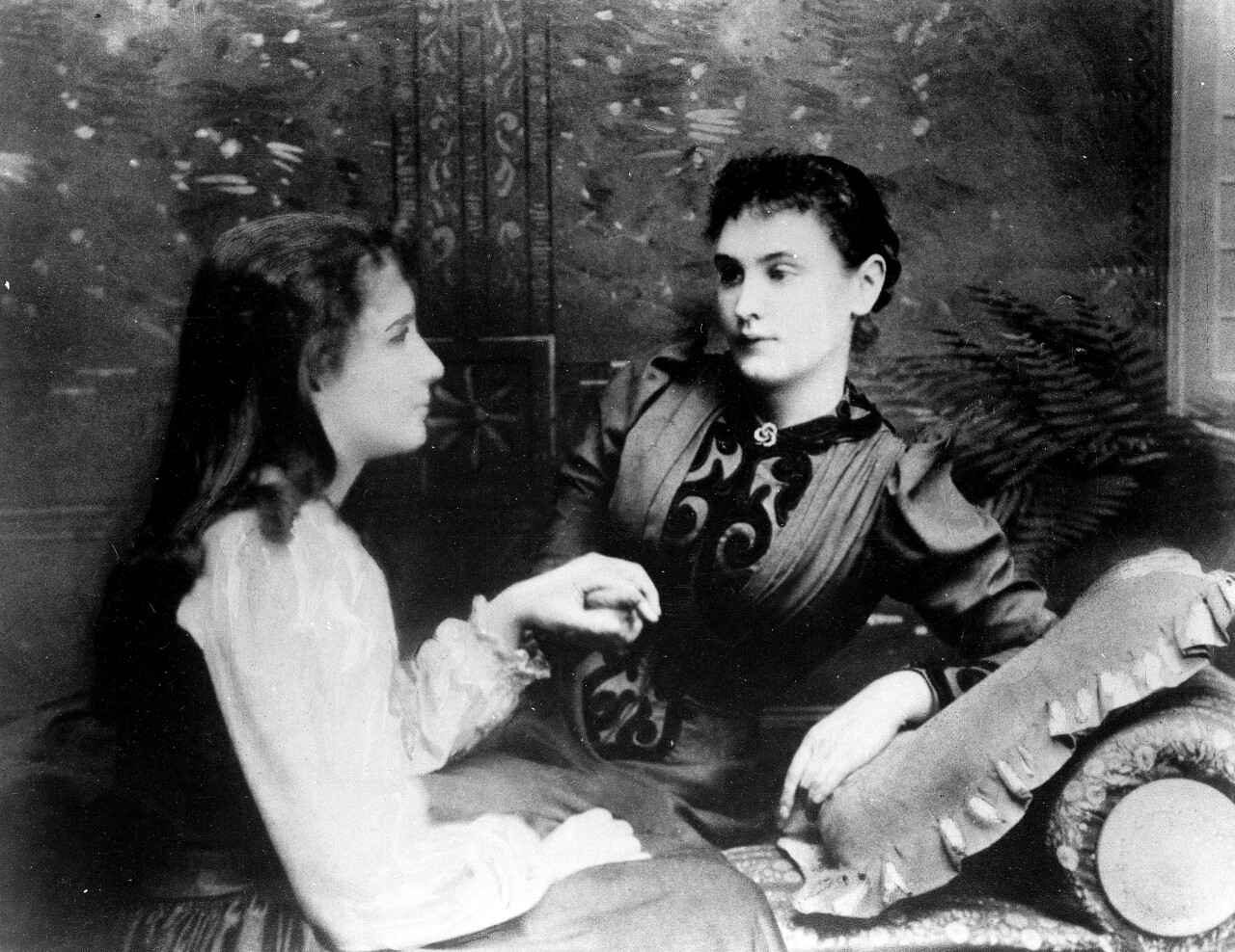 Helen Keller, left, at age 13, is photographed with her teacher, Anne Sullivan, in 1893 at an unknown location. Keller was nineteen months old when a disease left her blind and deaf. (AP Photo)