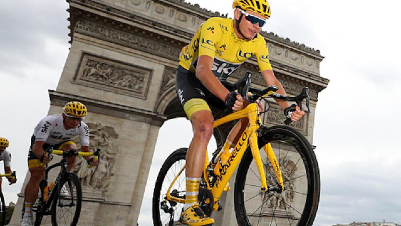 Tour de France rider crashes when accosted by police officer after race