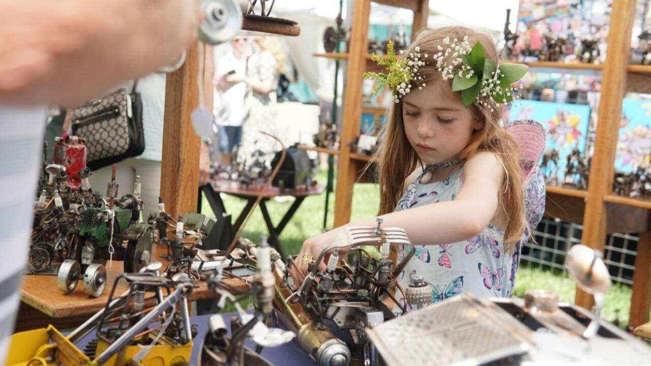 Kid at art fair.JPG