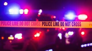Police line tape file photo night