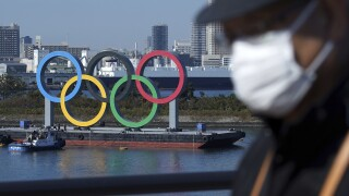 Japan vaccination uncertainty casts doubts over Olympics