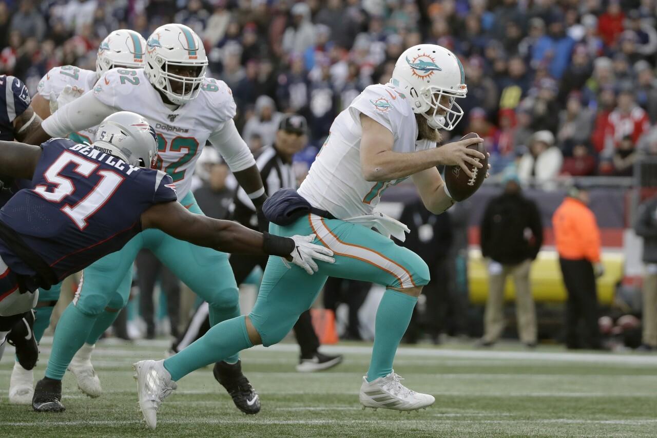 Miami Dolphins QB Ryan Fitzpatrick evades Ja'Whaun Bentley in December 2019